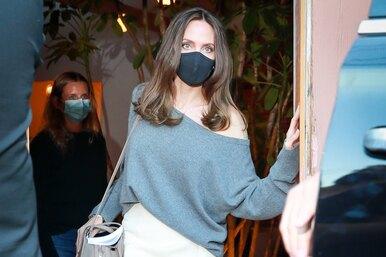 Свитер наодно плечо июбка «опасного» цвета: Анджелина Джоли удивила романтичным нарядом