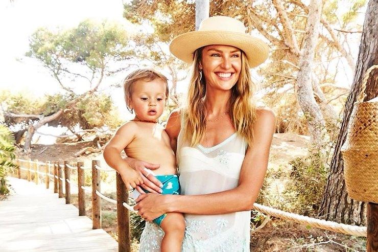 Кэндис Свейнпол вмятной накидке ишляпе отдохнула ссыновьями напляже