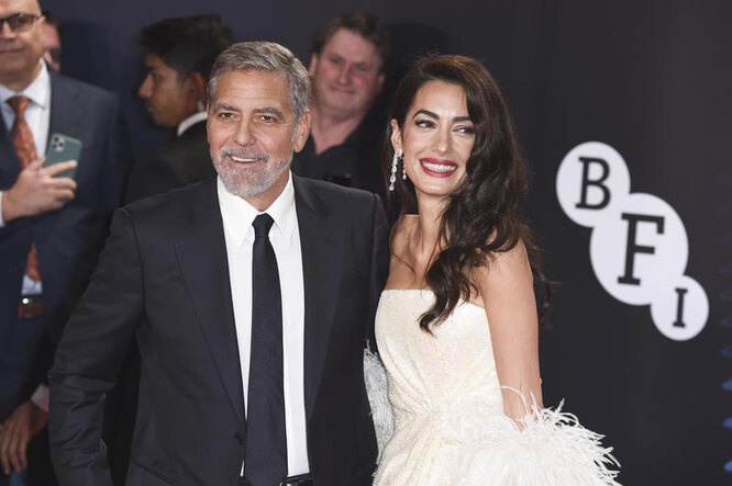 Джордж и Амаль Клуни на премьере