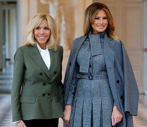 Мелания Трамп или  Брижит Макрон: кому из первых леди больше идет костюм